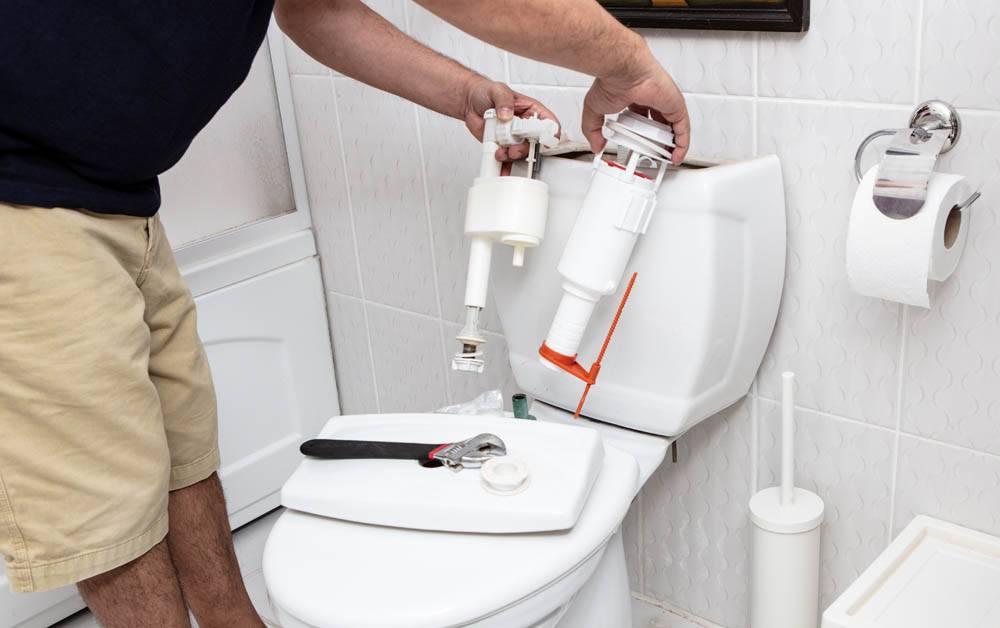 bathroom toilet being repaired