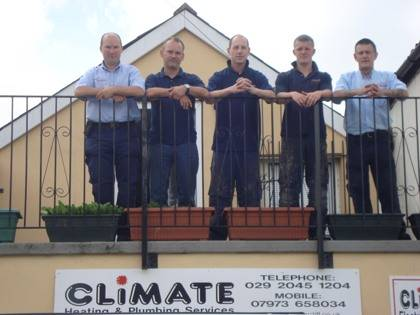 climate cardiff plumbers and heating engineers stood on balcony at climate house