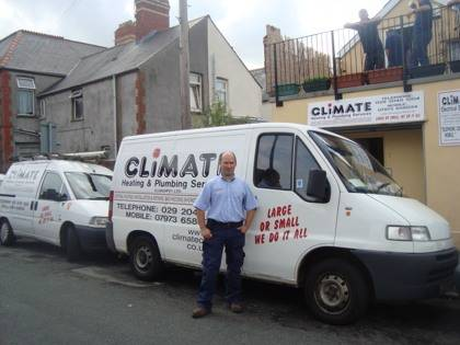 climate cardiff plumber in front of fleet vans parked by climate house